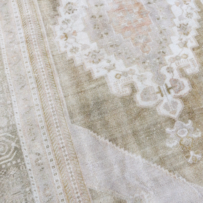 This large vintage Turkish has beautiful neutral colors with subtle olive and peach accents. Taşpinar.
