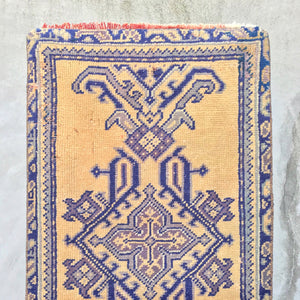 This vintage Uşak Turkish runner is one of the most vibrant ones we've run across. Deep, vibrant blues and purples on a yellow background. 2x9'7