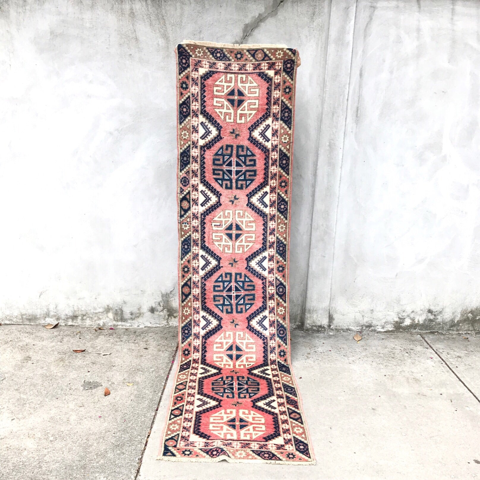 This vintage Turkish runner is a perfect size for a smaller kitchen or a narrow hallway! Amazing pink and navy geometric design with neutral accents. 2'3x9'2