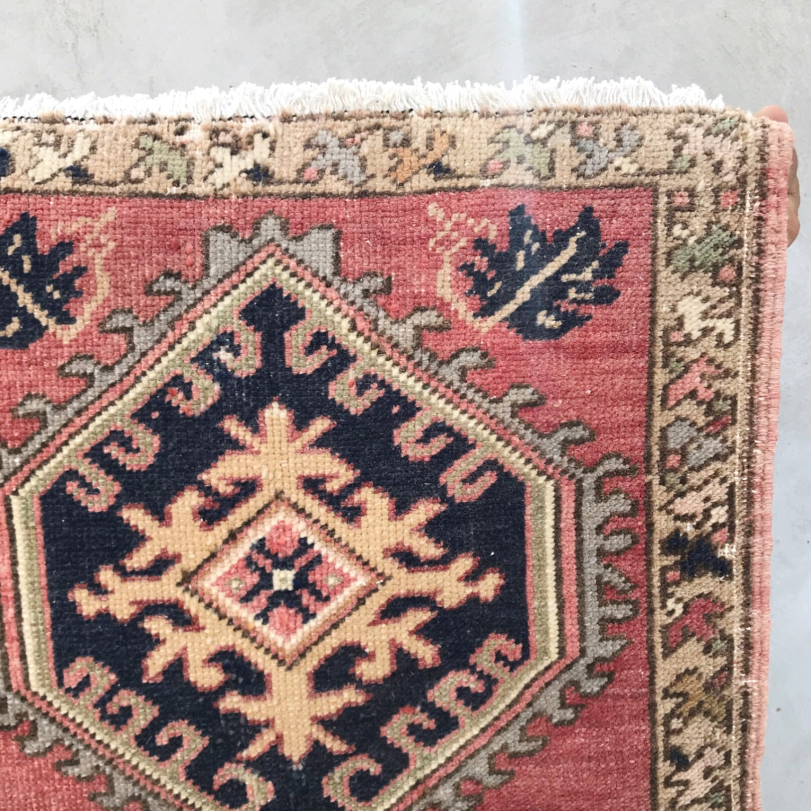 This vintage Yastik has beautiful salmon and navy.  Great for entryways, bathrooms, kitchens and layering. 1'9x2'10