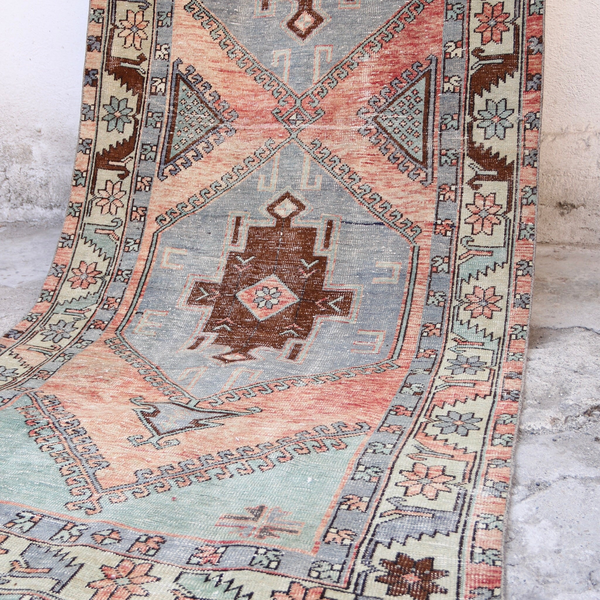 This handwoven vintage Turkish rug has beautiful soft blues and reds. Konya