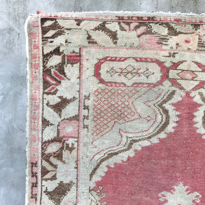 This handwoven vintage Turkish rug has a super soft pile and absolutely stunning warm pinks and salmons. Cream, light sage, and gray/brown accents.  3'3x6'4
