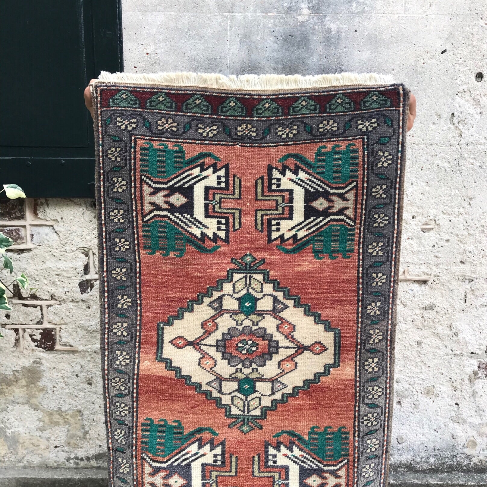 This vintage Yastik has a beautiful teal on a rusty peach background.  Great for entryways, bathrooms, kitchens and layering. 1'10x2'10.
