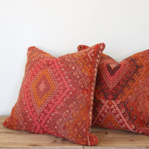 Cicim rugs have embroidery and beautiful detail. Our pillowcases are made from recycled handwoven vintage Turkish kilims.  Zipper closure. Insert not included. Natural dyes. Wool. Each pillow is one of kind.   This is a set of 2. Dark pink background with orange, pink, peach, and charcoal accents.