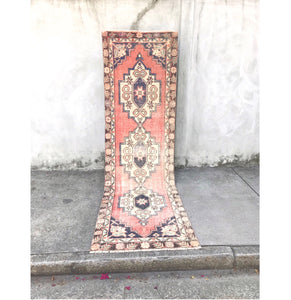 This vintage Turkish runner is a great size and has fantastic colors! The main color varies from peach to rust. Navy and blue accents. 2'7x9'3