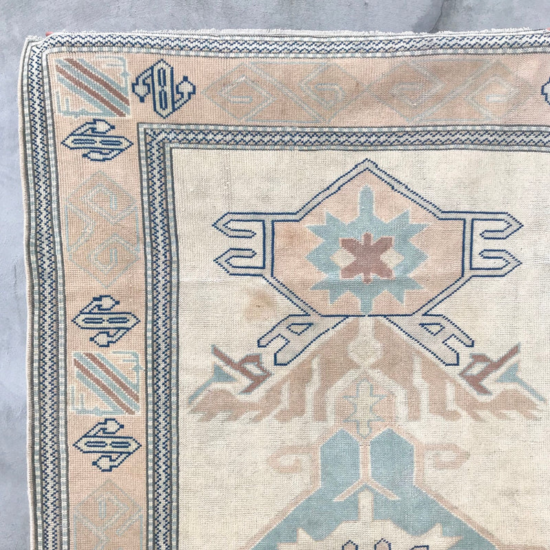 handwoven vintage Turkish rug tribal peach and blue
