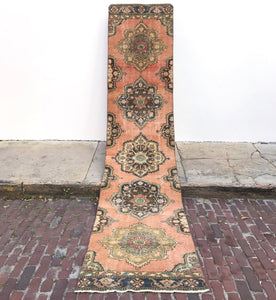 This vintage Turkish runner is a stunner! Amazing peach background with blue accents. 2'9x12'2