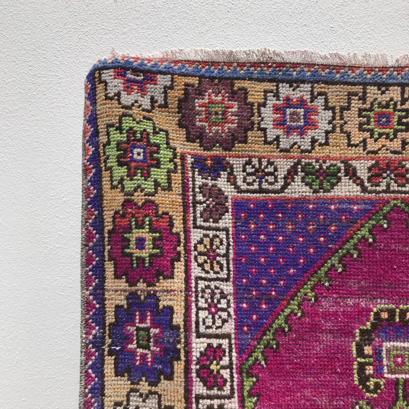 This vintage Turkish runner is a great size and has fantastic colors! Purple and magenta pink with green and yellow accents. 2'9x10'