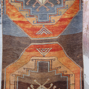 This handwoven vintage Turkish rug has an amazing tribal design with gorgeous orange, blues, grays, and browns. Sivas.