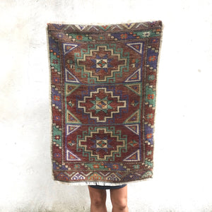 This vintage Yastik Has beautiful earthy colors in a geometric design. Super soft pile. Great for entryways, bathrooms, kitchens and layering. 1'9x2'7