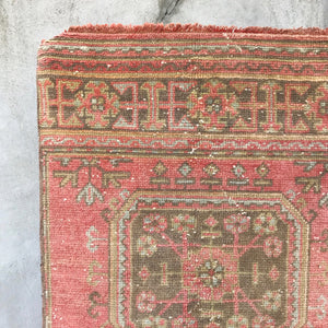 This vintage Turkish runner is an amazing warm pink with light blue, green and neutral accents... and it's an Uşak! 2'7x11