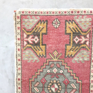 This vintage Yastik has beautiful pinks and blues.  Great for entryways, bathrooms, kitchens and layering. 1'9x3'2