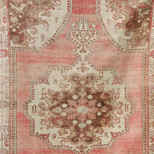 This handwoven vintage Turkish rug has a low but incredibly soft pile. Beautiful warm pink and neutral. Avanoz.