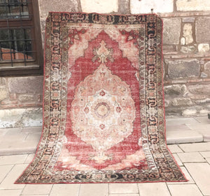 This large vintage Turkish rug is a beautiful blue and gray and tan accents!  6'8x10'5