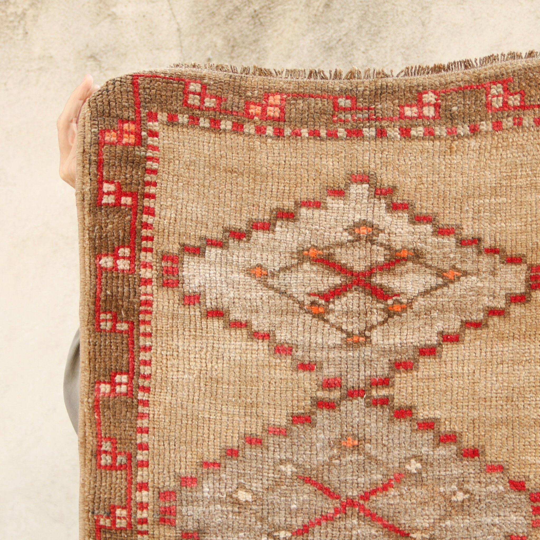 This vintage Turkish rug is a beautiful neutral with pink and red accents. Great for entryways, bathrooms, kitchens and layering.