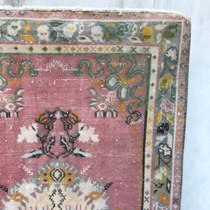 The Damla handwoven vintage rug is from the Denizli region. Beautiful pinks and blues. 3'4x6'2
