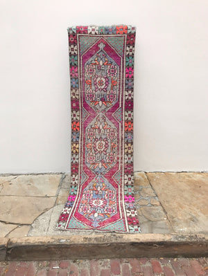 This vintage Turkish runner is a great size and has fantastic colors! Purple and blue with green and aqua accents. 2'6x8'10.