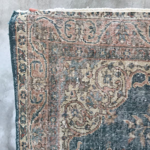 This beautiful vintage Isparta Turkish rug has a beautiful blue with neutral accents. 3'7x6'7