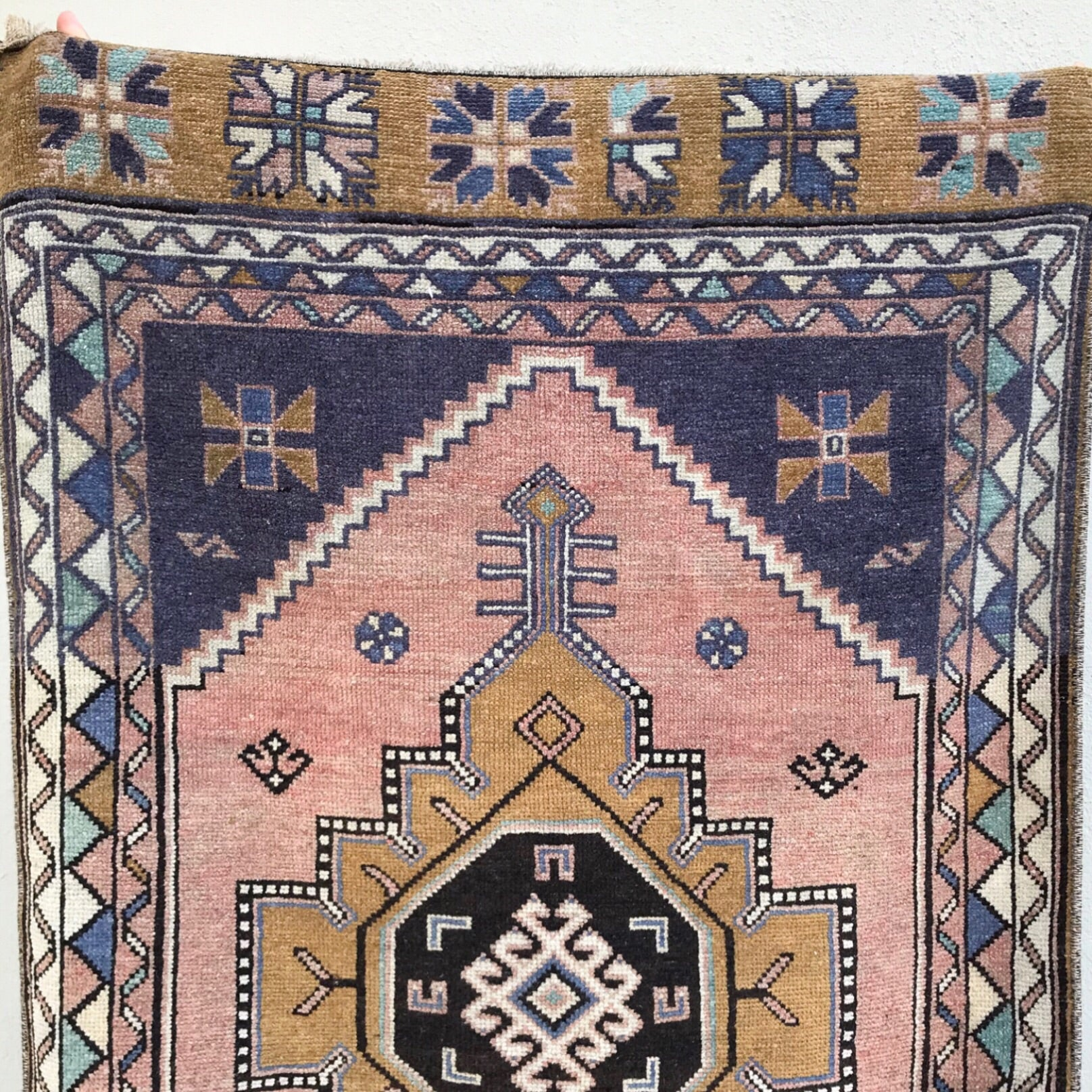 This vintage Anatolian Niğde rug has amazing colors and design. The runner is sized at 2'6x12'5.