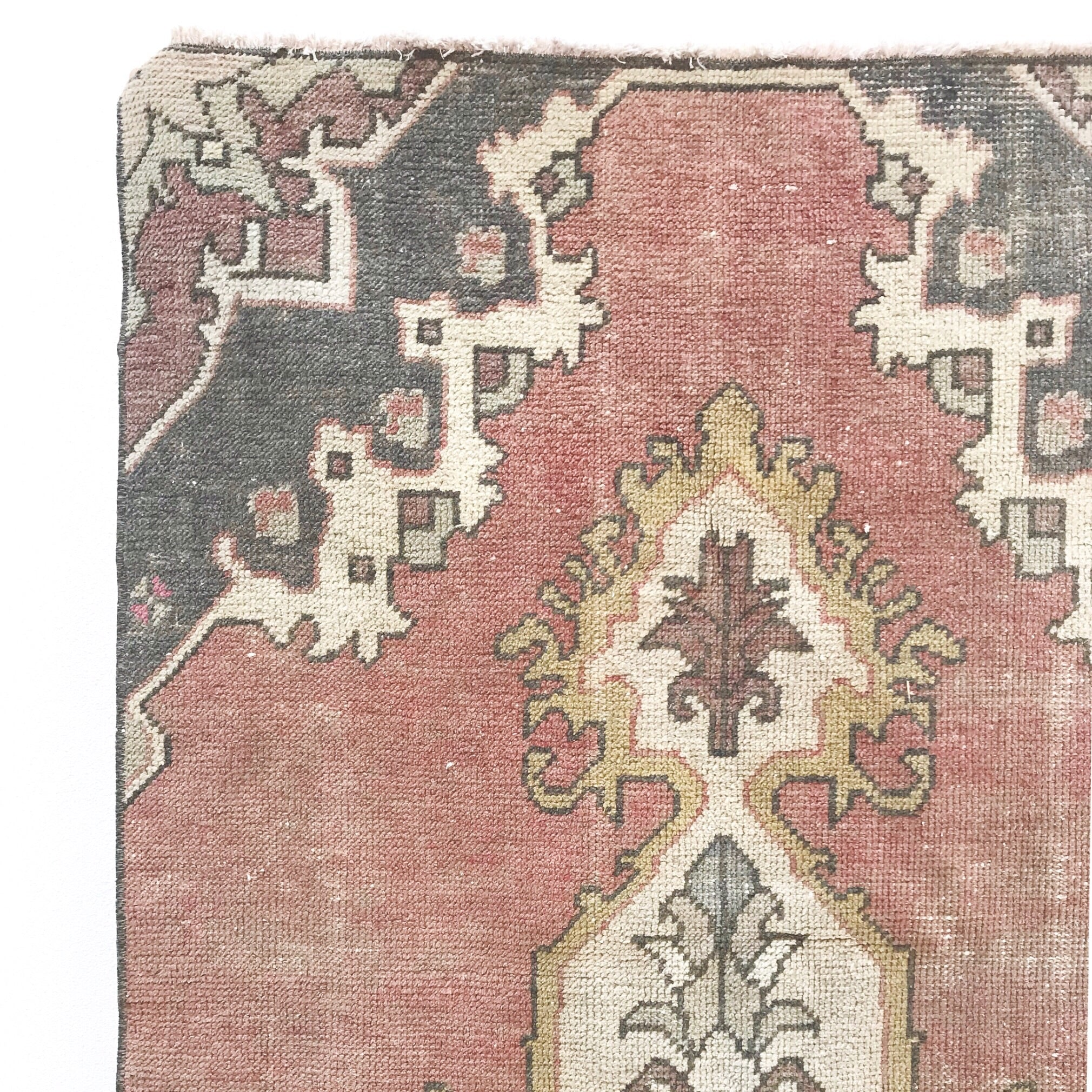 The Lida handwoven runner is a vintage Turkish avanos rug. Beautiful dusty pinks and grays with yellow accents. 3x7'10