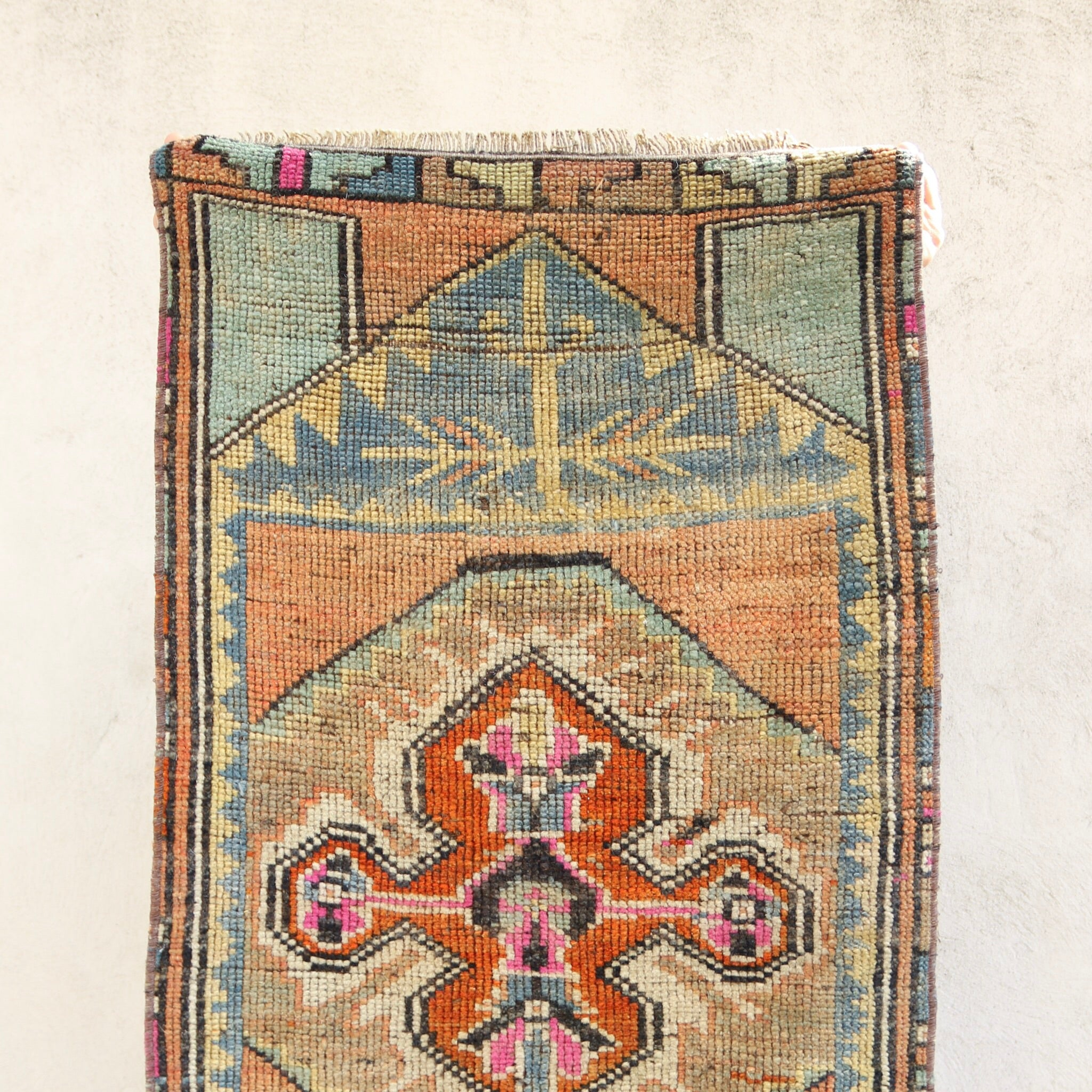 This vintage Turkish rug is a beautiful colors and a great texture. Great for entryways, bathrooms, kitchens and layering.
