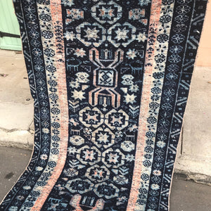 This vintage Turkish runner is one of the most beautiful ones we've run across. Deep, vibrant blues with peach/blush and off white accents. This one has a super soft pile. 3x9'6