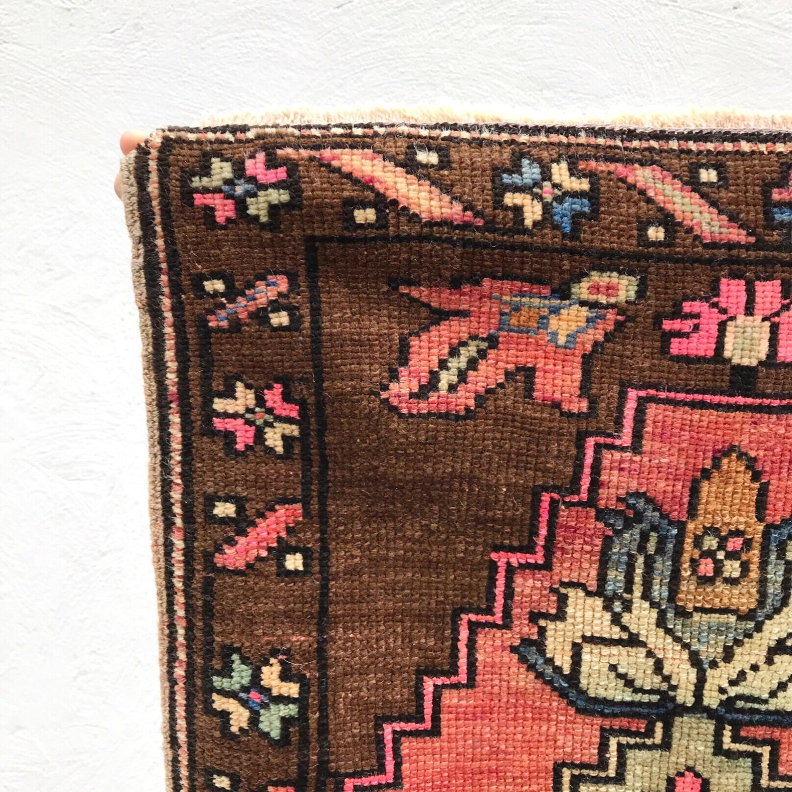 This small handwoven vintage Turkish rug has a great pinks and peaches with a very cool color change. Super soft pile. Great for entryways, bathrooms, kitchens and layering. 25x44""
