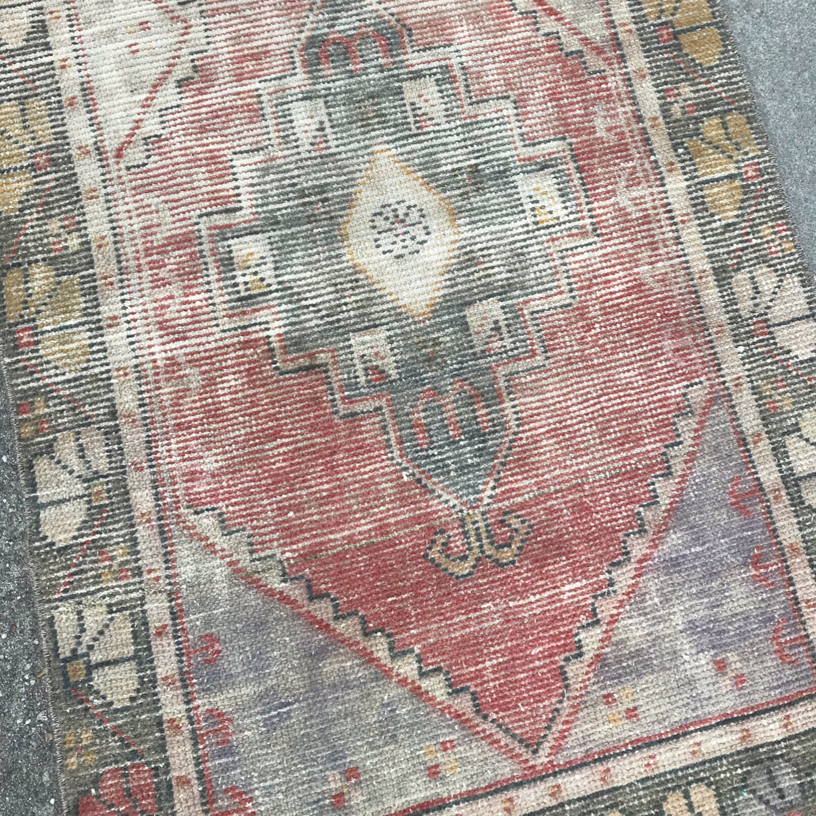 This vintage Turkish runner is a great size and has fantastic muted red colors and a worn texture! 3x10'2