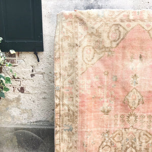"The Cansın handwoven vintage rug is an amazing peach/pink with blue and neutral accents. The name Cansın means ""you are my life'. 4'6x8'6."