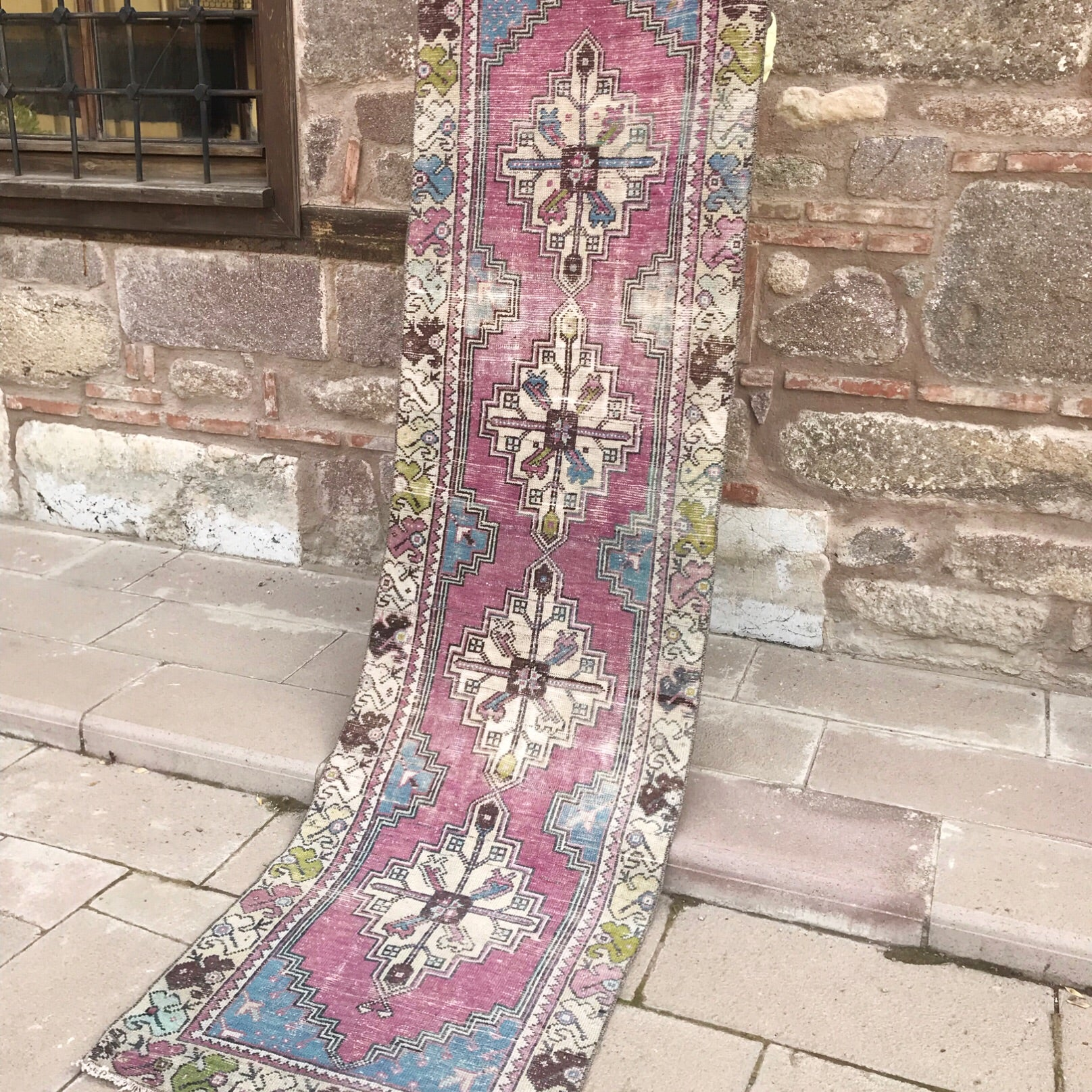 This vintage Turkish runner is a great size and has fantastic colors! Purple and blue with green and aqua accents. 2.5x8'10.