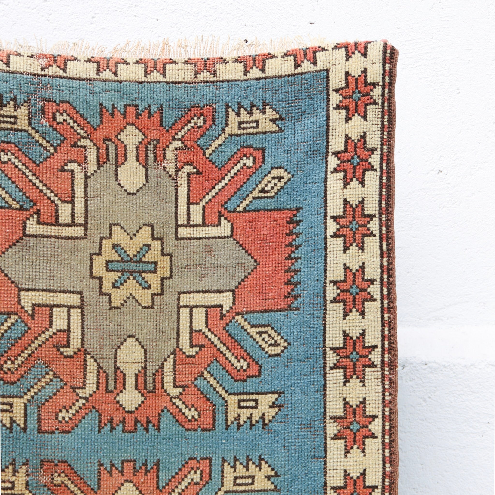 This handwoven vintage Turkish runner has an amazing tribal design and stunning blues with salmon and neutral accents. Kars.