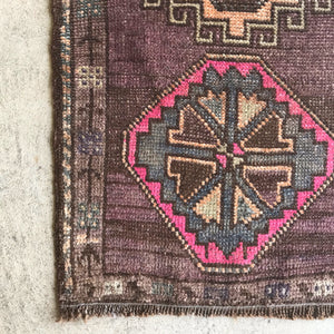 This small handwoven vintage Turkish rug has great pink, purple and neutral colors. Perfect for entryways, bathrooms, kitchens and layering. 19.5x41""