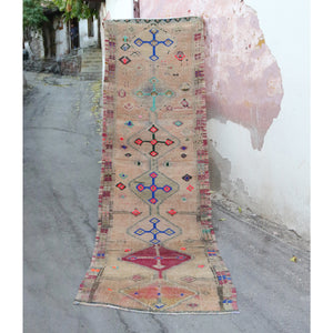 This handwoven vintage Turkish rug is an amazing neutral with vibrant accents and a thick soft pile. Herki.