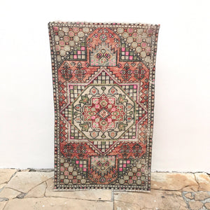 This 3x5 handwoven vintage Turkish rug has a great design and fun colors with black and white accents. Great for entryways, bathrooms, kitchens and layering. 3'3x5'4