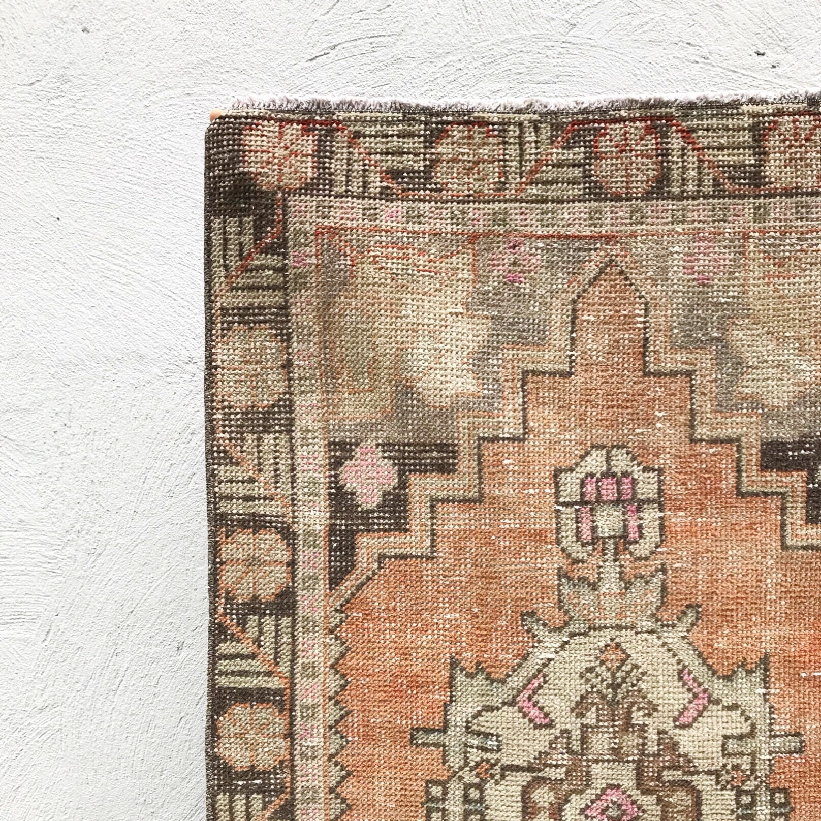 This vintage Turkish runner has fantastic muted colors. Pink and orange accents. 2'8x8'11