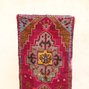 This vintage Turkish rug is a beautiful fushia with yellow, black and blue accents. Great texture and pile. Great for entryways, bathrooms, kitchens and layering.