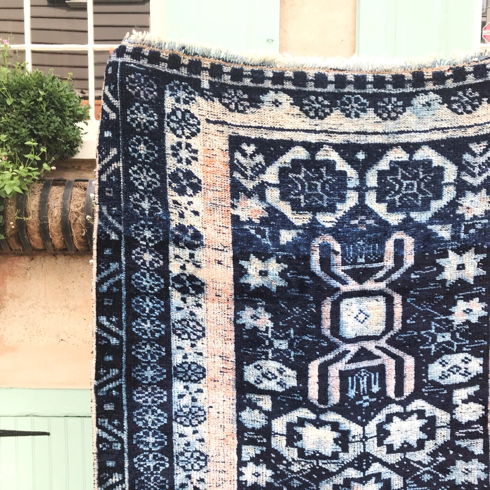 This vintage Herki Turkish runner is a tribal rug, and is one of the most beautiful ones we've run across. Deep, vibrant blues with peach/blush and off white accents. This one has a super soft pile. Incredibly soft and glossy wool is typical of this region.  3x9'6