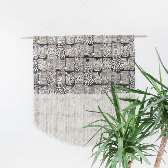 Patchwork Block Printed Fringe Wall Hanging in Back