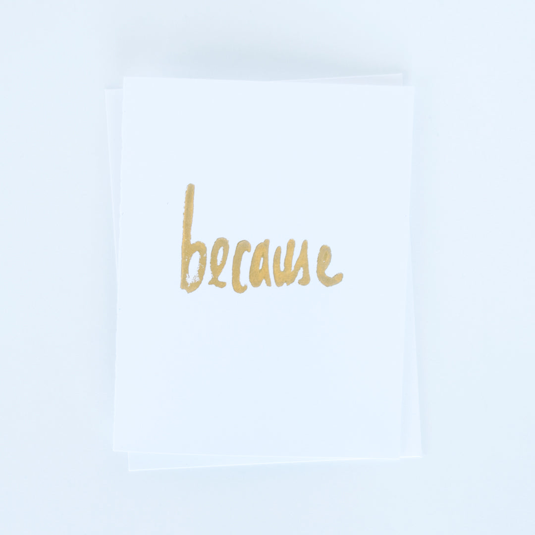 "On sale, typographic block printed card with word ""because"" in gold ink"