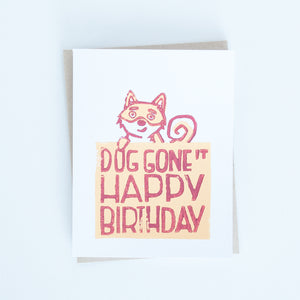 "Japanese shiba block printed in orange and maroon with words ""Dog gone it Happy Birthday"" greeting card"
