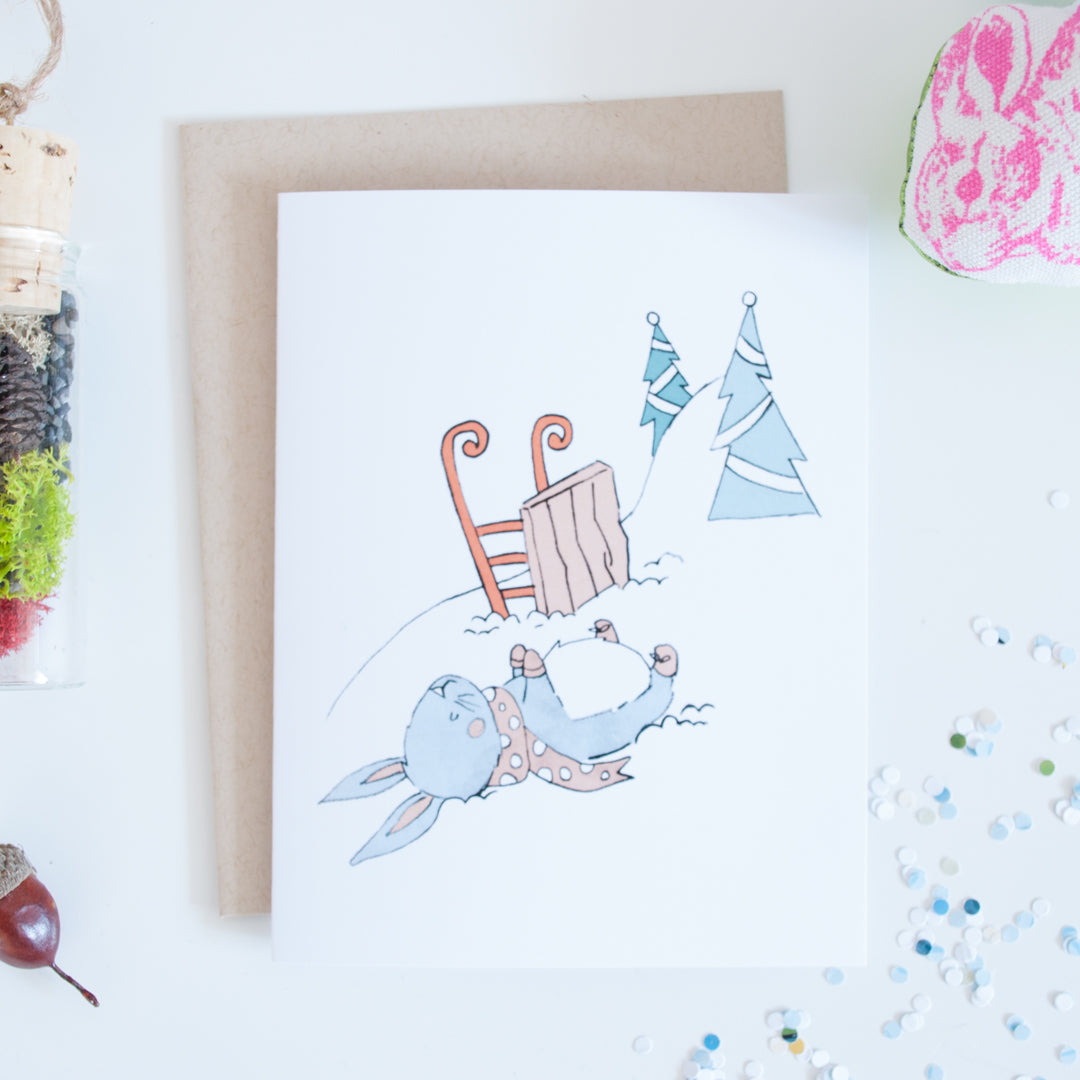 On sale, a tired bunny on the snow slopes with sled illustrated holiday card
