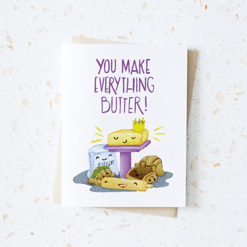 "Butter on a pedestal with pastries, flour and rolling pin around it illustration with words ""You make everything butter"" greeting card"