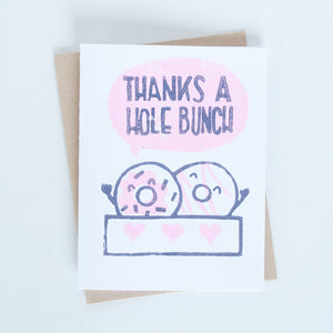 "Box of 2 doughnuts illustration block printed in pink and purples with words ""Thanks a hole bunch"" greeting card"