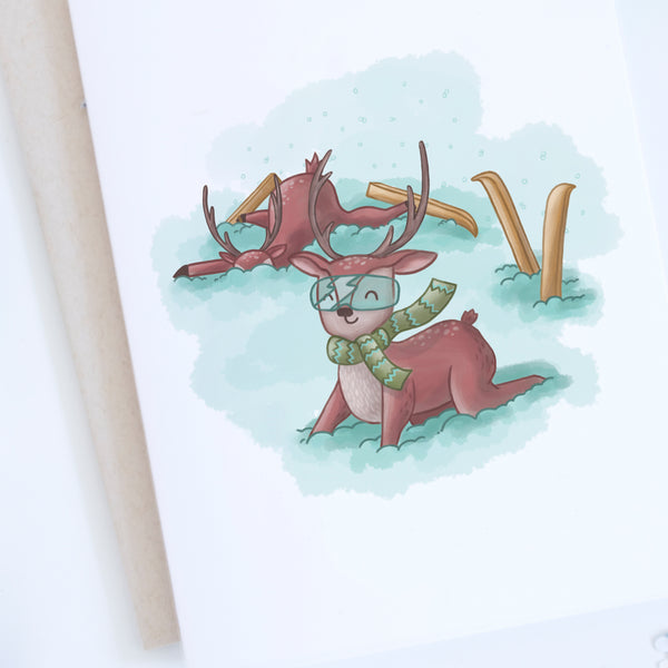 Close up of the deers skiing holiday card
