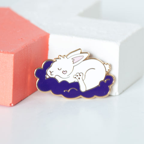 Sleeping white bunny on a fluffy purple cloud enamel pin