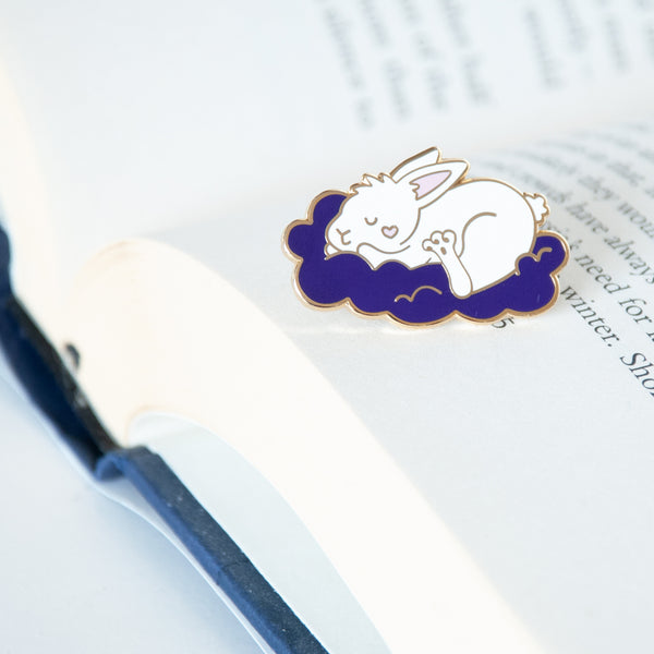 Sleeping white bunny on a cloud with a heart on its cheek enamel pin