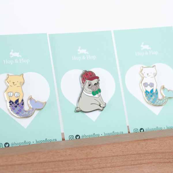 Pins shown on branded backing cards, sherlock holmes pug and cat mermaid pins