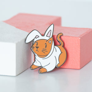 Cosplay ginger cat in a white bunny outfit hard enamel pin