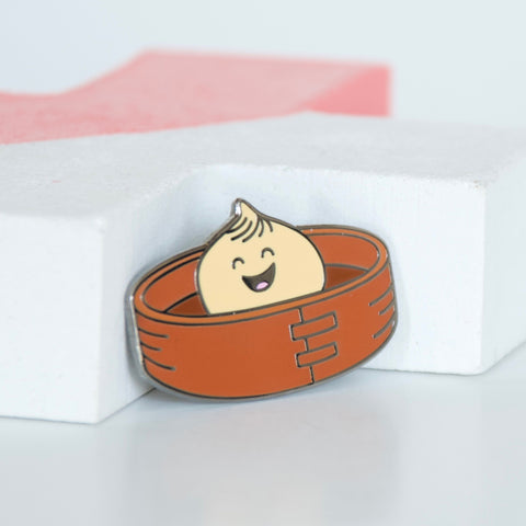 Asian Dumpling or Bao in a bamboo steamer basket hard enamel pin.
