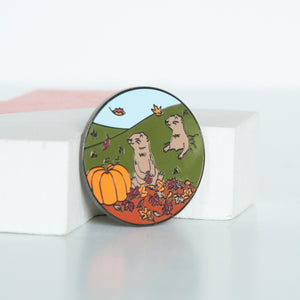 On sale canadian wildlife praire dog in a pile of fall leaves and beside a pumpkin enamel pin